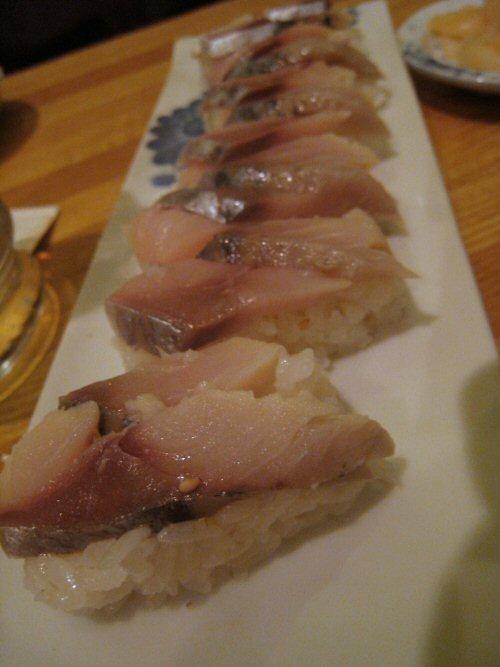 Japanese Horse Mackerel Sushi On Black Background Stock ...  Japanese Mackerel Sushi