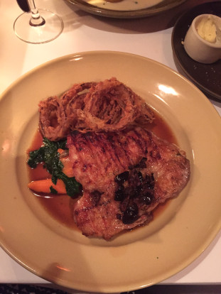 chez panisse cafe riverdog farm chicken leg al mattone with fried onoin rings, glazed carrots, spinach, black olive sauce